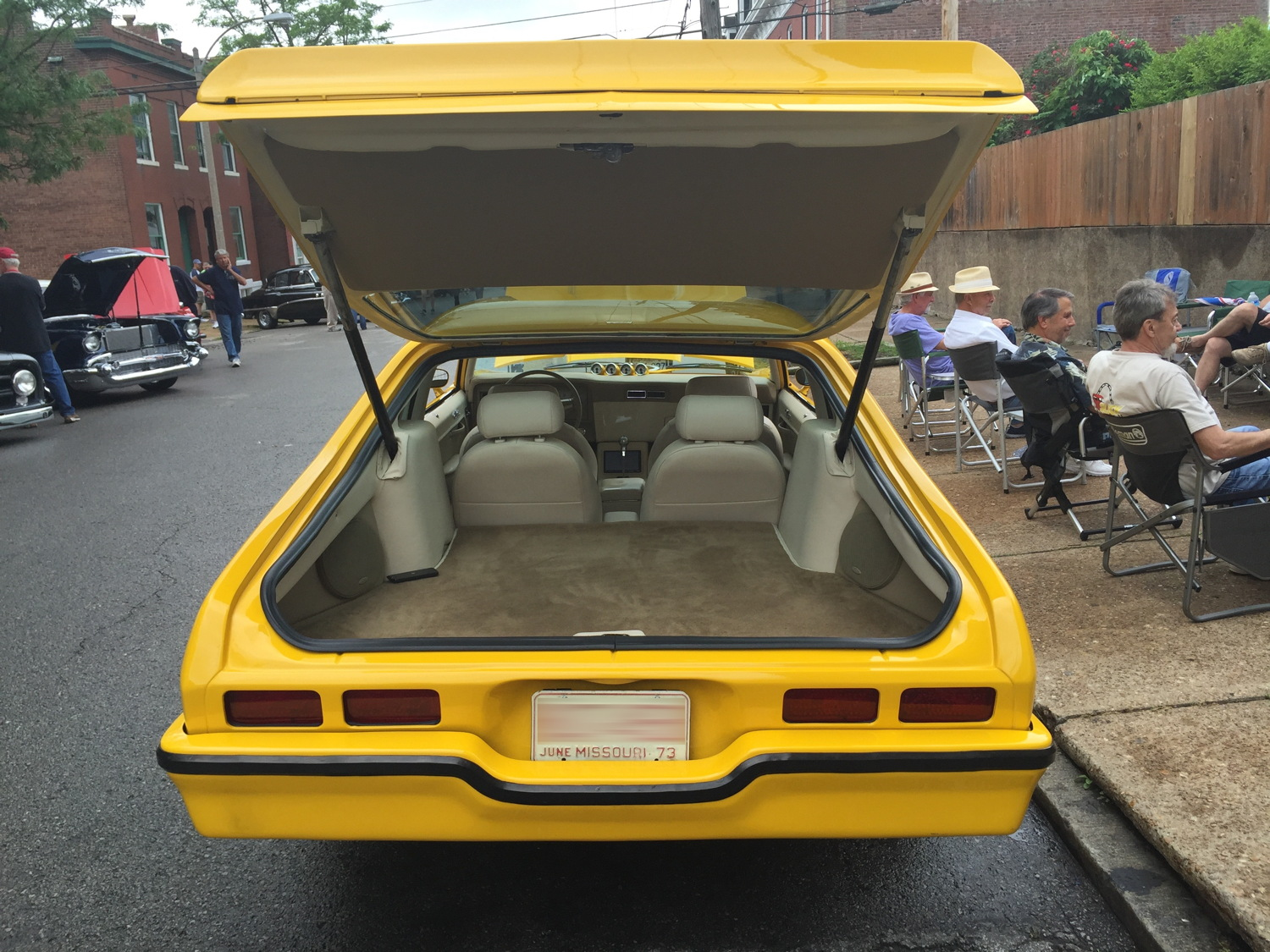 1973 Chevrolet Nova Hatchback Interior with custom stereo, carpeted cargo compartment and four custom bucket seats.
